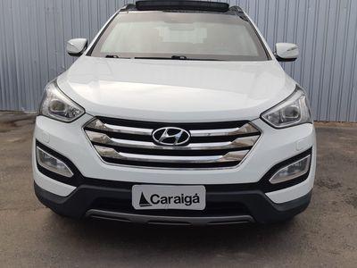 Hyundai Santa Fe 3.3L V6 4x4 (Aut) 7L 2014}